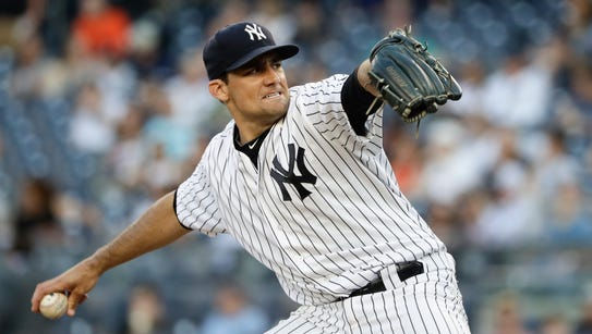 New York Yankees' Nathan Eovaldi delivers a pitch during
