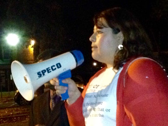 New York Civil Liberties Union organizer Guisela Marroquin speaks to protesters gathered in front of the East Ramapo district offices Tuesday night.