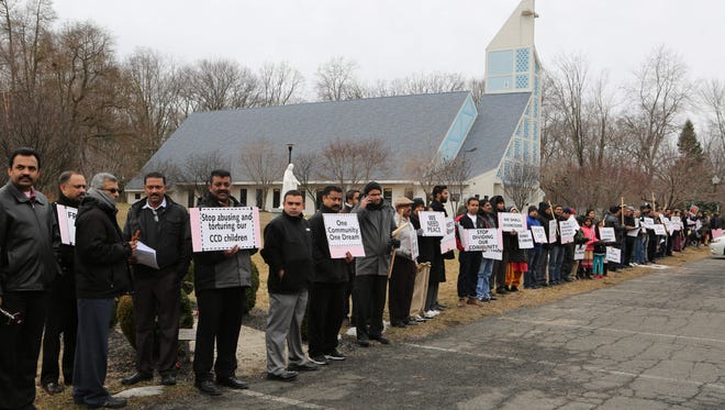 Members of the Indian Knanaya Catholic Community stage a peaceful protest outside of the Marian Shrine Chapel in Stony Point, Feb. 21, 2016. The currently appointed priest for the community, Fr. Joseph Mathew moved their Sunday Mass and CCD classes out of their community center and to the Marian Shrine.