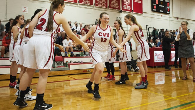 CVU's Marlee Gunn (13) takes the court during player introductions during a high school girls basketball game on Monday night.