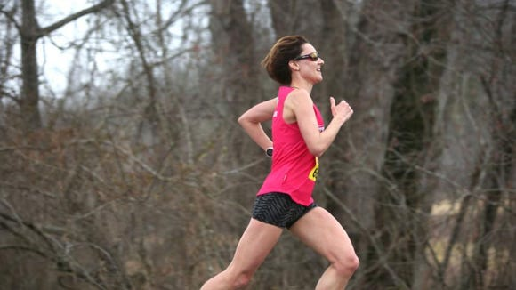 Amber Reece-Young, 37, of Asheville, was the female winner of the Frostbite 10K race in Fletcher on Sunday, Feb. 21.