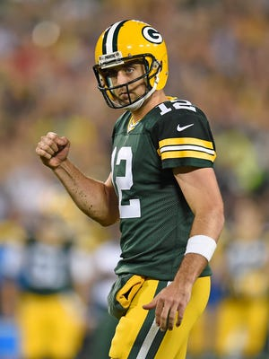Green Bay Packers quarterback Aaron Rodgers (12) celebrates a touchdown against the Kansas City Chiefs at Lambeau Field.
