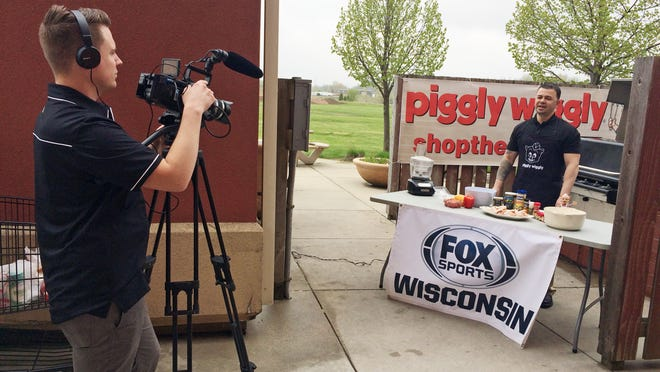 "Potawatomi Hotel and Casino Chef Stephan Gonzalez, right, tapes a segment for a FOX Sports Wisconsin segment of ""Tailgate Tips"" at the south-side Piggly Wiggly in Sheboygan on Friday. The segment will air during an upcoming Milwaukee Brewers game."