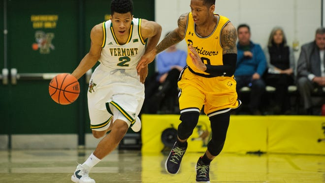 Vermont's Trae Bell-Haynes (2) and UMBC's Jairus Lyles lead their teams into the America East men's basketball championship game on Saturday morning at Patrick Gym.