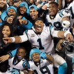 Carolina Panthers' Cam Newton celebrates with teammates during the second half the NFL football NFC Championship game against the Arizona Cardinals on Jan. 24, in Charlotte, N.C.