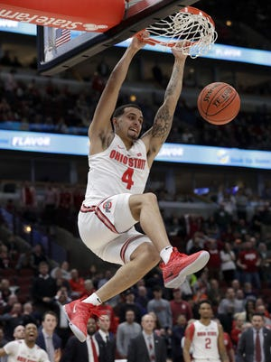 Ohio State's Duane Washington Jr. (4) dunks during the second half of of Thursday's Big Ten tournament game against Indiana.
