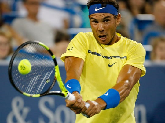 Rafael Nadal returns a shot in the first set of the