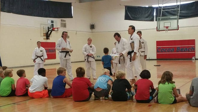 Students receiving their certificates at the Cocoa Beach Rec Center, Thursday.