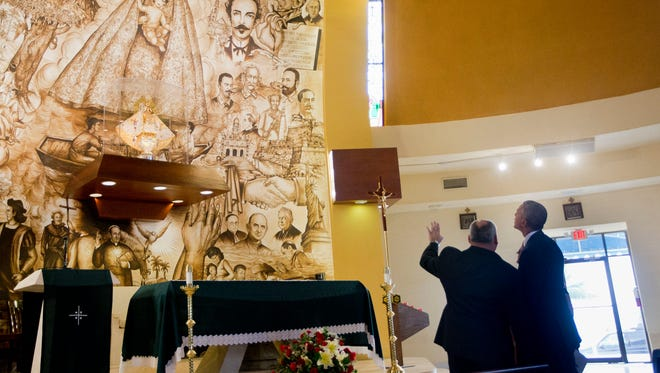 President Obama, with Father Juan Rumin Dominguez at the Shrine of Our Lady of Charity.