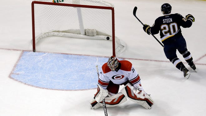 St. Louis Blues' Alexander Steen celebrates after scoring past Carolina Hurricanes goalie Justin Peters during the third period.