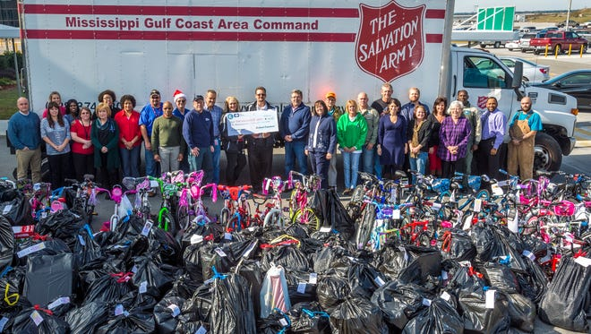 Ingalls Shipbuilding employees donated clothes and toys to 124 Mississippi children through the Jackson County Salvation Army's Angel Tree program this December.
