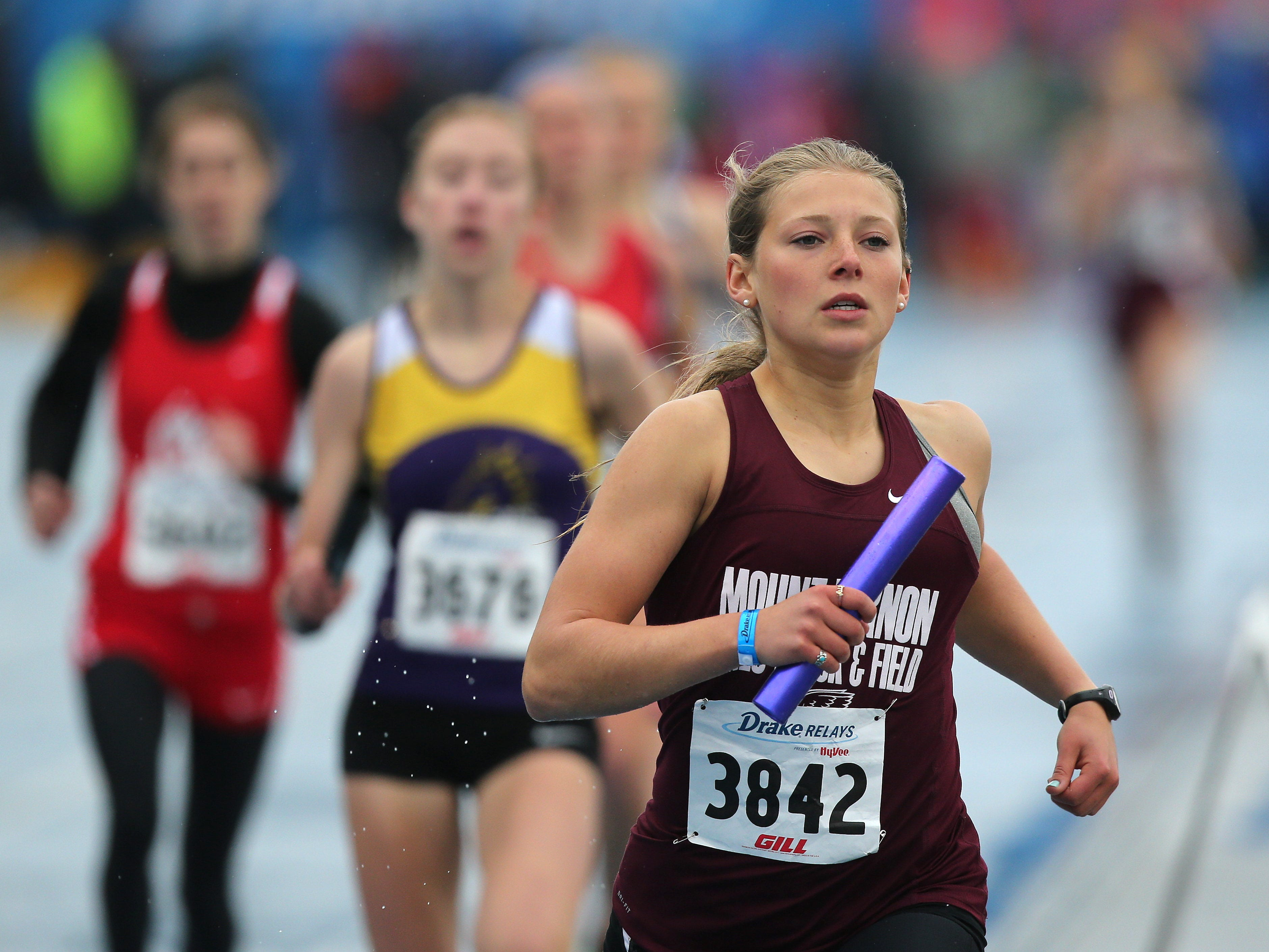Mount Vernon sophomore Faith Anton runs the baton in the girls 4x800 meter relay during the Drake Relays at Drake Stadium in Des Moines on Saturday, April 25, 2015. Davenport Assumption's Mallory King took the lead from Waukee in the third leg and Joy Ripslinger extended it for a win in 9:20.99, ahead of last year's 9:23.78 victory.