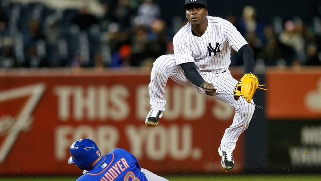 Didi Gregorius forces out Michael Cuddyer Mets to complete the double play to end the game on April 24. Gregorius has been working with veteran infielder Alex Rodriguez on the finer points of fielding.