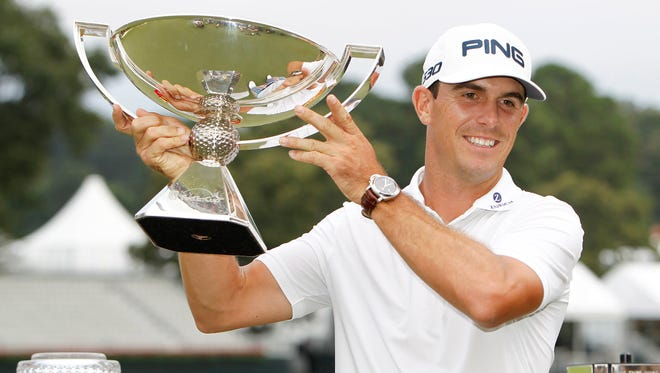Billy Horschel poses with the FedEx Cup after winning the Tour Championship at East Lake Golf Club in Atlanta on Sept. 14, 2014.