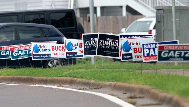 Political campaign signs dot the landscape in high traffic areas, like the corner of Bayfront Pkwy, and East Chase Street.