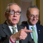 Senate Minority Leader Harry Reid of Nev., accompanied by Sen. Charles Schumer, D-N.Y., speaks to reporters on Capitol Hill in Washington, Tuesday, March 17, 2015. Reid announced that he will retire after 2016 and is backing Schumer to replace him as Senate Minority Leader.