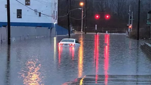 A white sedan in flood waters at Carrol Street and Kellogg Avenue in the East End on Friday morning. Cincinnati police said the vehicle was found unoccupied overnight. They tracked owner down at his place of employment. He told them he escaped out the sunroof and faces a fine that could be as high as $2,000.