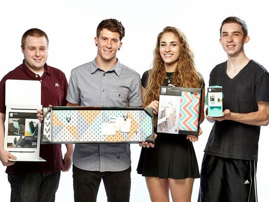 Samuel Pawlak of Big Flats, at right, is shown with his desktop organizer, Cacti. Other Philadelphia University students show their award-winning designs that are also being sold at Target stores. Products, from left, are Bunky, a bedside stand to hold electronics and books; Trig, a graphic pegboard to hold items; Roo, an over-the-door laundry bag that converts to a shoulder tote.