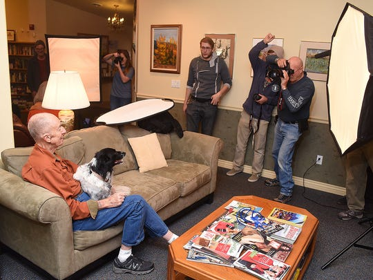 George Bacon, left, poses for a portrait with his dog, Magnolia, during a visit on Tuesday from San Juan College's intermediate digital photography class. The students in Tony Bennett's class visited Namaste House Assisted Living in Farmington to shoot portraits of the residents.