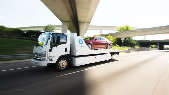 A vehicle is delivered on one of Carvana's trucks. Carvana is an online, used-car company that allows consumers to have vehicles delivered to their doorstep. It expanded to Indianapolis in November.