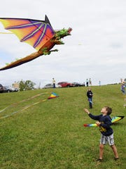 Ryan Babral and his father, David Babral, fly kites at the Coyner Springs Kite Fly in Waynesboro.