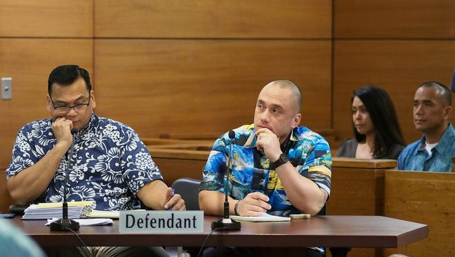 """Mark Torre Jr., front right, and his attorney Joaquin """"Jay"""" Arriola, attend a pre-trial conference at the Superior Court of Guam on Jan. 20, 2017."""