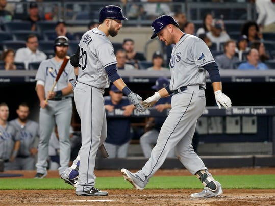 Tampa Bay Rays' Lucas Duda, right, is congratulated by Steven Souza Jr. (20) as he crosses the plate after hitting a solo home run against the New York Yankees during the seventh inning of a baseball game, Friday, July 28, 2017, in New York. (AP Photo/Julie Jacobson)