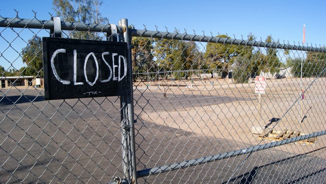 A closed sign hangs on the gates of Bakery Nursery, which closed in December after 46 years in business, Dec. 30, 2014.