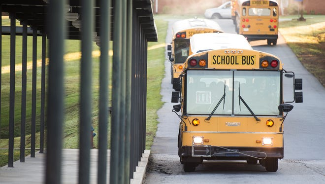 School buses pull into Liberty Middle School on the first day of school on Thursday, Aug. 17, 2017.