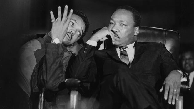 Martin Luther King Jr., seated with aide Jesse Jackson, arrives at the Mason Temple in Memphis on April 3, 1968.