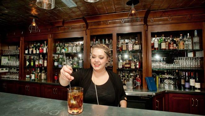 "Bartender Julie Jordan prepares the Hell or High Water Speakeasy's signature drink, the ""Calling Card,"""