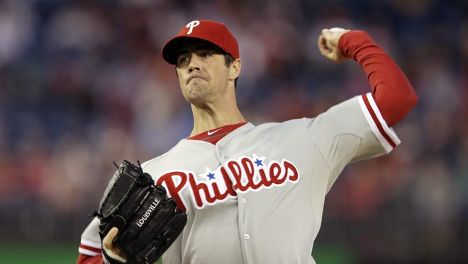 FILE - In this Sept. 14, 2013, file photo, Philadelphia Phillies starting pitcher Cole Hamels delivers against the Washington Nationals during the first inning of a baseball game at Nationals Park in Washington. Hamels said he will not throw off the mound for at least another week after suffering from fatigue following his latest throwing session. (AP Photo/Pablo Martinez Monsivais, File)