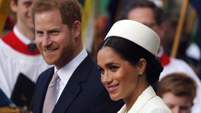 FILE - In this Monday, March 11, 2019 file photo, Britain's Prince Harry and Meghan, the Duchess of Sussex leave after the Commonwealth Service at Westminster Abbey in London. Prince Harry and Meghan Markle are to no longer use their HRH titles and will repay £2.4 million of taxpayer's money spent on renovating their Berkshire home, Buckingham Palace announced Saturday, Jan. 18. 2020.
