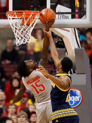 Ohio State's Kam Williams, left, goes up for a shot