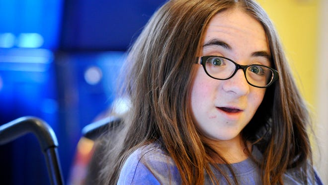 """Fiona Murphey has osteogenesis imperfecta, better known as """"brittle bone disease."""" She is 15 years old. She requires around-the-clock care and wheelchair transportation, etc."""