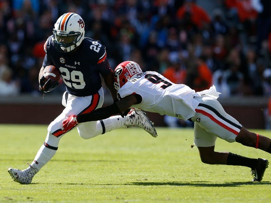 Auburn running back Jovon Robinson (29) carries the ball as he tries to get around Georgia cornerback Reggie Wilkerson (9) during during the first quarter of an NCAA football game, Saturday, Nov. 14, 2015, in Auburn, Ala. (AP Photo/Butch Dill)