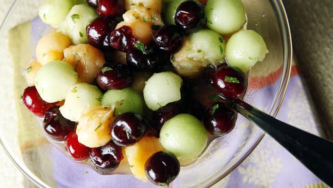 Melon-bing cherry salad is a fresh side dish to go along with steaks or burgers off the grill