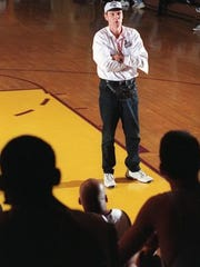 Basketball Hall of Famer Rick Barry speaks at a clinic at St. Rose High School in 1998.
