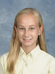 Menard seventh-grader Meredith Seeling won first place at the district level for her Patriot's Pen essay contest entry.