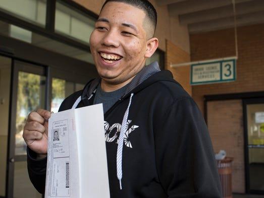 Ramon Maldonado. 19, a dreamer, shows off his driver