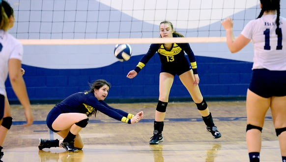 Asheville Christian Academy's Sarah Buchanan, left,
