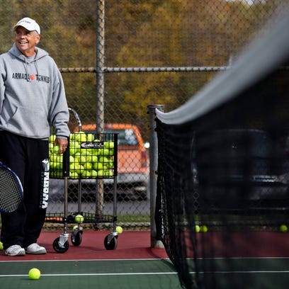 Coach Dave Fredette watches over players during tennis