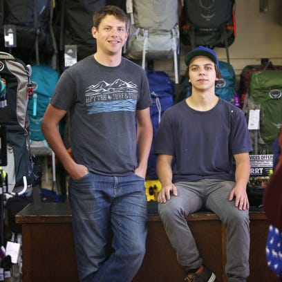 Bryan Wolf, co-owner, and Eli Staggs, employee of Roads