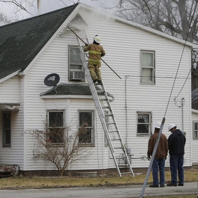 Smoke pours from a Romney home Monday as Randolph Township