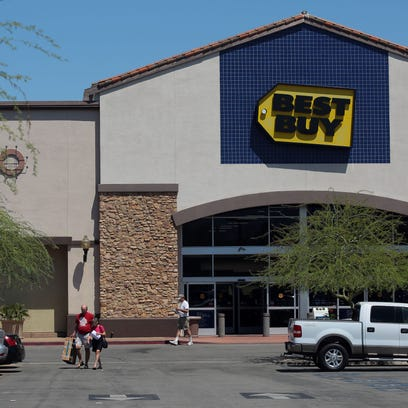Shoppers exit Best Buy in La Quinta on April 20. In