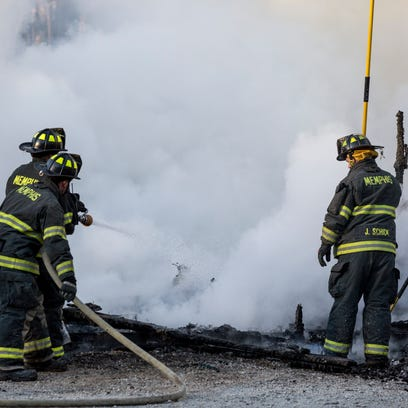 Firefighters from seven area departments work to battle