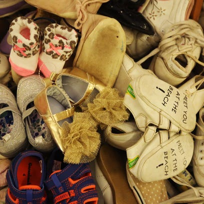 Baby shoes are put on display in the rotunda of the