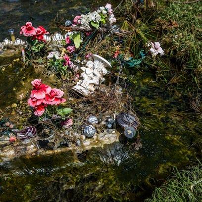 Flooded graves at Lake Trafford Memorial Gardens on