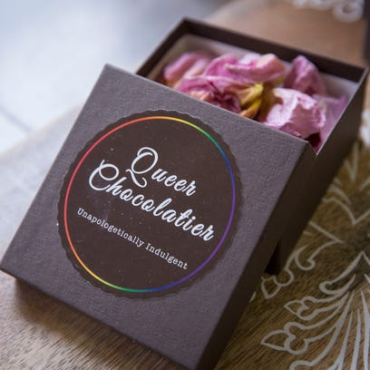Small boxes with truffles dusted in coco powder are