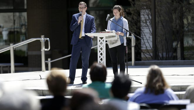 USA Today Network-Wisconsin editor Jim Fitzhenry and reporter Rory Linnane talk about the Kids in Crisis series during the Mental Health Awareness Month kickoff program Monday at Houdini Plaza in Appleton.